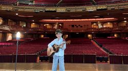 Louie Phipps, 9, has the stage to himself during a taping of a live performance at the Wang Theatre.