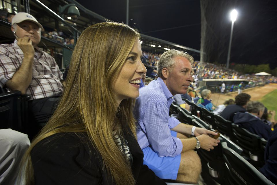 Tyler Tumminia sits in the stands of the Charleston RiverDogs opener with Peter Freund, a Yankees minority owner and co-owner of the team.