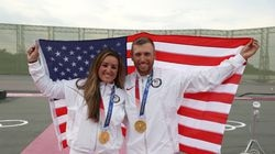 Amber English (left) and Vincent Hancock pose with the American flag and their gold medals after sweeping the women's and men's skeet finals.