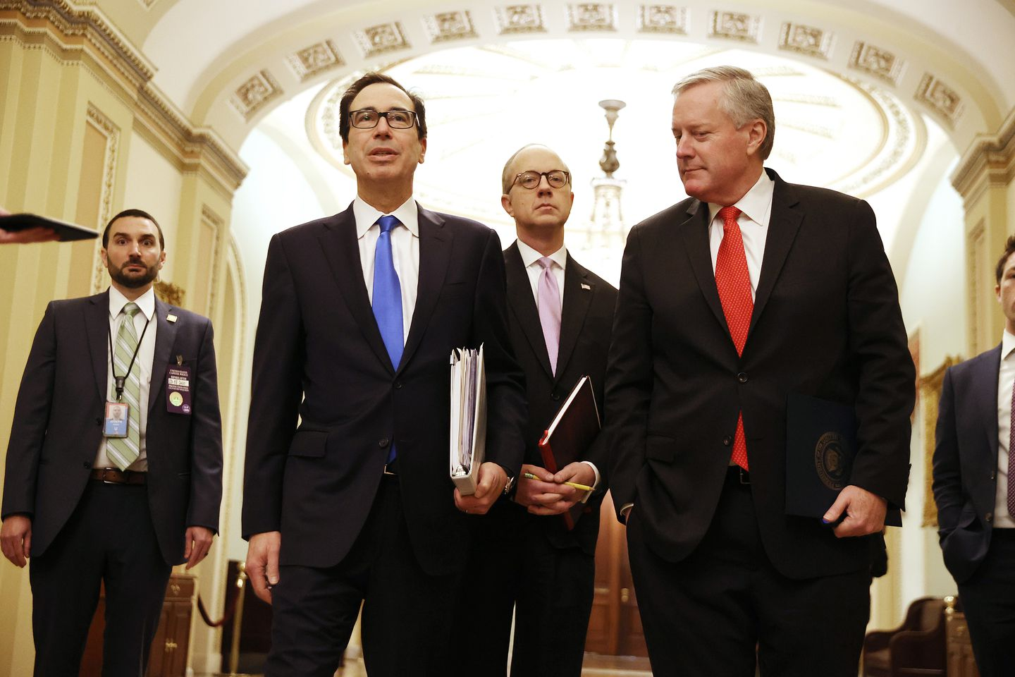 Treasury Secretary Steven Mnuchin arrived at the US Capitol with White House Director of Legislative Affairs Eric Ueland (center) and White House Chief of Staff Mark Meadows (right) to continue negotiations on a $2 trillion economic stimulus in response to the coronavirus pandemic Tuesday.