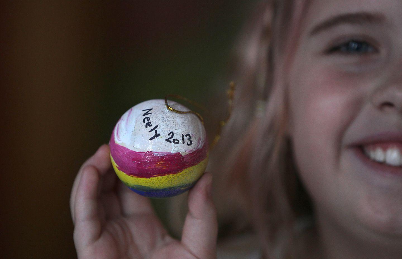 Nine-year-old Neely Harrington showed the item she made for her teacher.
