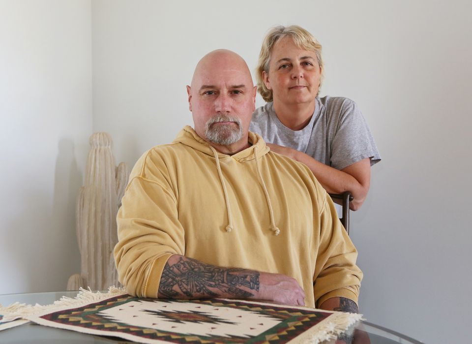 John Moore, 54, with his wife, Cathy, in their home in Apple Valley, Utah. Moore is battling stage IV metastatic melanoma; a precision treatment helped him, but only for a year.