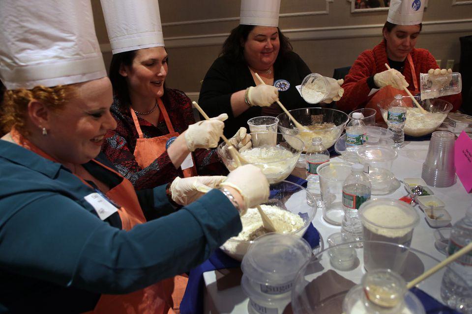 From left: Elana Margolis of Sharon, Nancy Hait of Easton, Deborah Daniels of West Bridgewater, and Nancy Marin of Mansfield making challah, a braided bread, during the Mega Challah Bake.