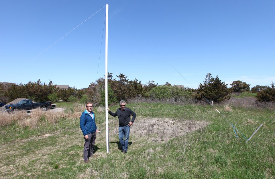 Eric Savetsky and Neil Paterson stood at one end of the proposed footprint of the building planned.