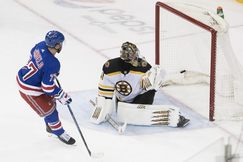 Bruins goalie Jaroslav Halak can't stop this game-winning shot by the Rangers' Tony DeAngelo in the seventh-round of the shootout.