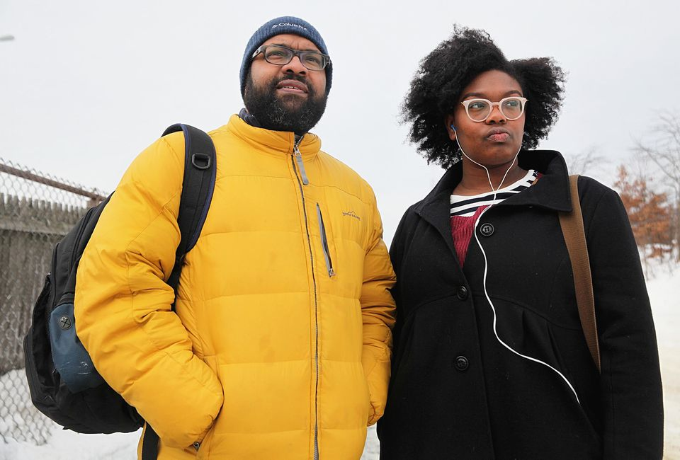 At the West Newton commuter rail stop, Jabari Asim and his daughter, Indigo waited for a delayed inbound train.