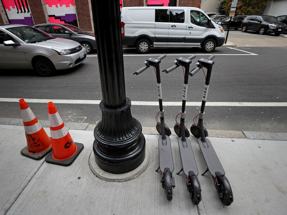 Scooters awaited riders on Weybosset Street in Providence. One concern is that they can an obstruction on sidewalks.