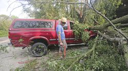 Adam Turley surveys the damage to his dad's truck in front of their home on Concord Center Drive in the Town of Concord, Wis., on Thursday, July 29, 2021.