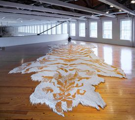 """Xu's """"1st Class,"""" a faux tiger-skin carpet made from more than a half million cigarettes."""