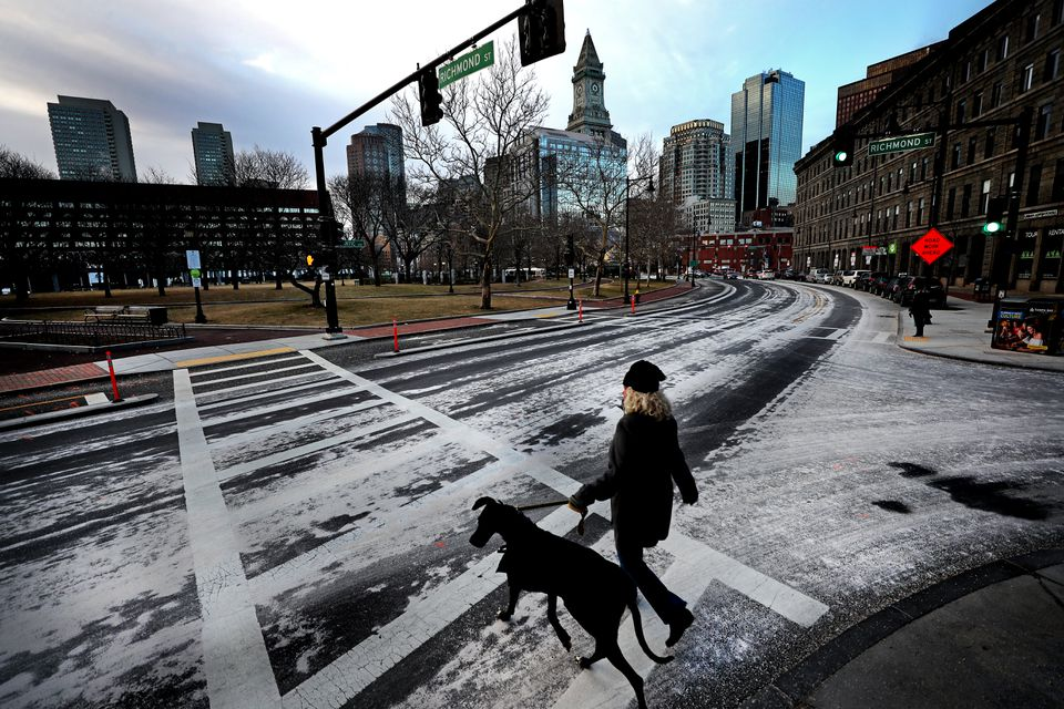 A layer of salt covered Atlantic Avenue in Boston in preparation for this weekend's storm.