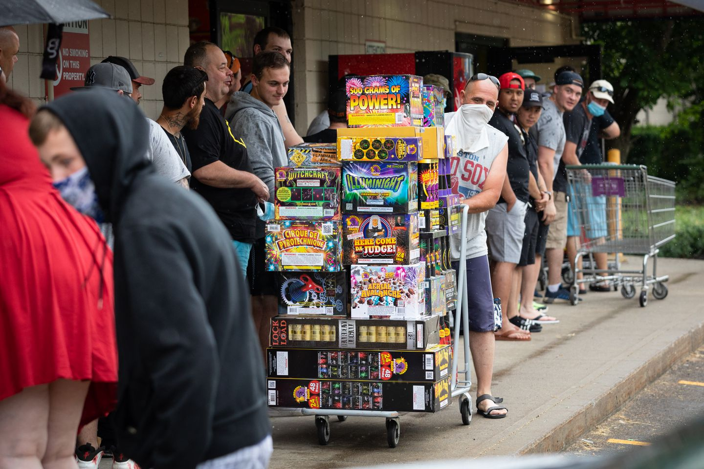 A Massachusetts man, who declined to identify himself, navigated a cart of fireworks past a long line Sunday in Londonderry, N.H.