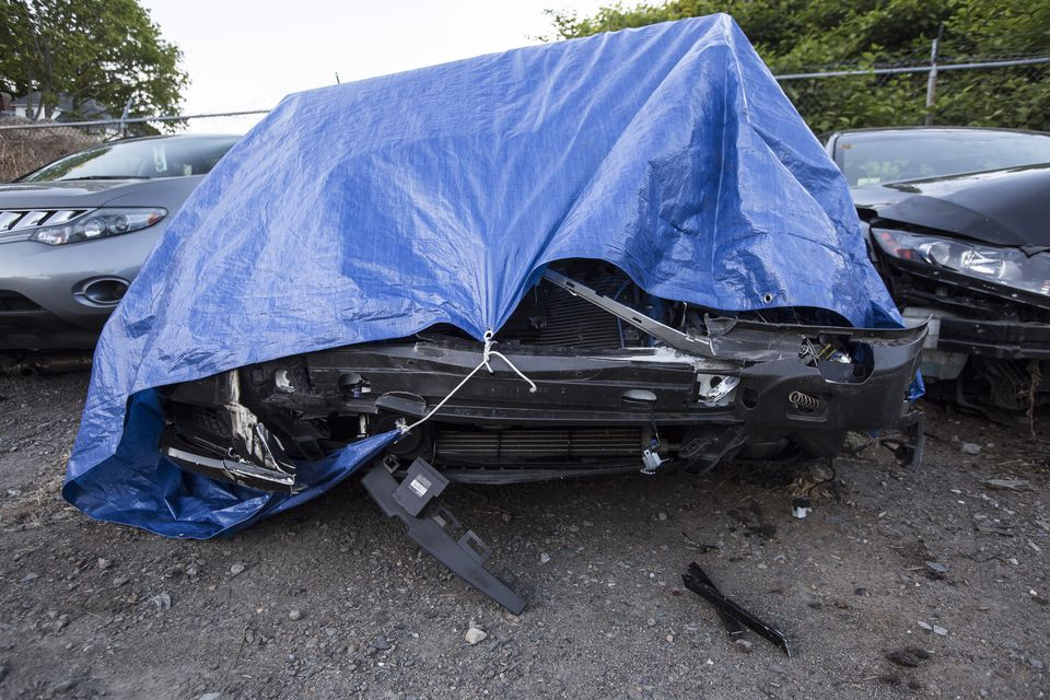 A damaged and abandoned Mercedes-Benz Maybach registered to New England Patriots linebacker Brandon Spikes.
