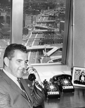 Mr. Driscoll in his office overlooking the Turnpike extension near the Prudential Center.