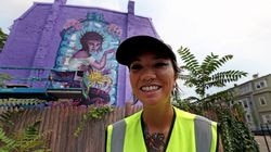 Lauren YS stood in front of their work-in-progress Wednesday on Chelsea Street. The Sea Walls Boston program brings a wave of new public murals, including one by celebrity artist Shepard Fairey.