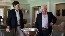 Rod Laver (right) with Longwood club president Stan Mescon and one of the trophies Laver won.