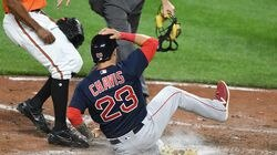 Michael Chavis slides in safely with the winning run in the 10th inning Saturday night in Baltimore.