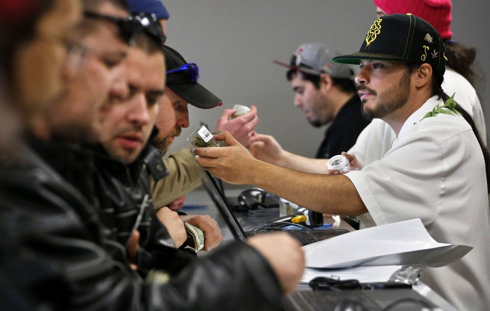 A crowd gathered at a sales counter in a Denver marijuana retail shop.