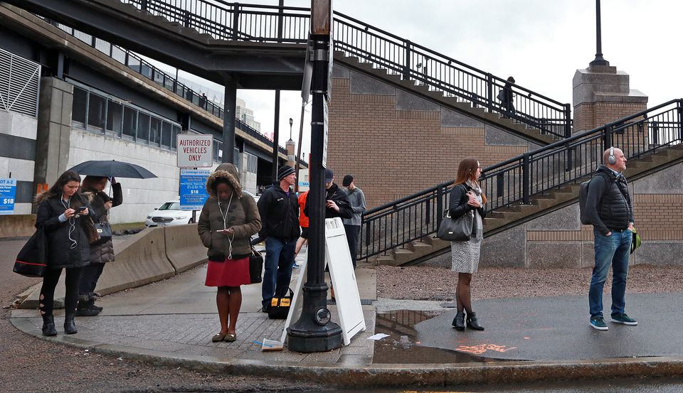 People waited for buses outside of the MBTA Silver Line station on Congress Street.