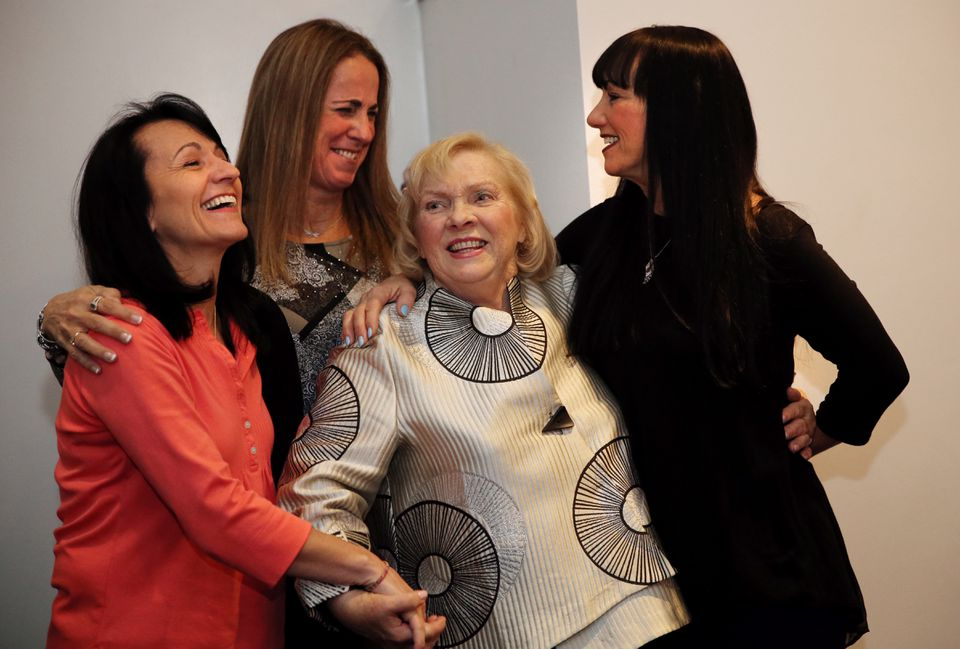 """Marcia Roussos is greeted by former students """"the Messina Girls,"""" sisters (from left to right) Marisa O'Dwyer, Beverly Fernald, and Christine Messina at a Nov. 21, 2015, event celebrating her 80th birthday and career as a figure-skating coach."""