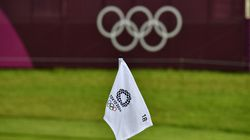 The Olympic Rings logo is seen on a flag on the green at the 18th hole in round 2 of the men's golf individual.