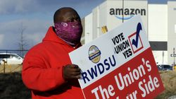 Michael Foster of the Retail, Wholesale and Department Store Union held a sign outside an Amazon facility where labor is trying to organize workers in Bessemer, Ala.