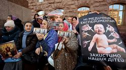 """Believers of Ukrainian Orthodox Church of the Moscow Patriarchate hold icons and placards reading """"No medical experiments, Protect our children"""" as they hold rally outside the city mayor's office on October 19, 2021, against Covid-19 vaccination."""