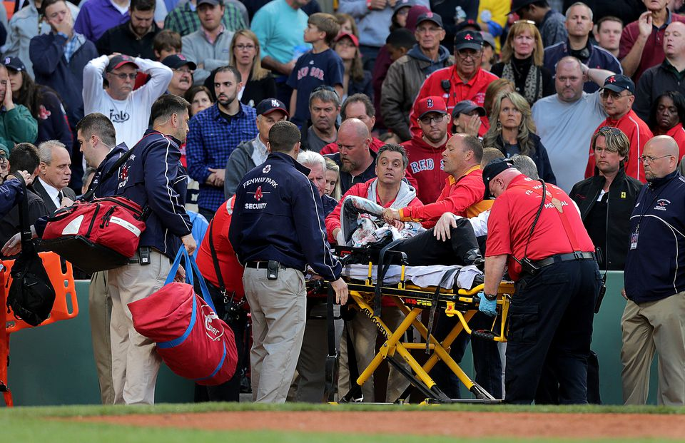 Medical personnel removed Tonya Carpenter after she was injured by a broken bat in the second inning of Friday's game.