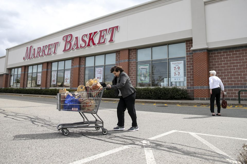 A shopper walked out of a Market Basket in Reading. The rival grocery chain has seen a 115 percent increase in business since the Stop & Shop strike began.