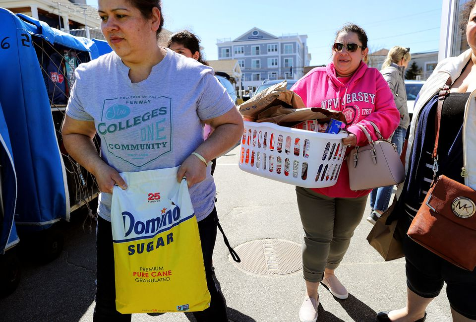 Rubidia Escobar (right) and Ofelia Duarte carried groceries at the Hyannis Ferry Terminal bought at Market Basket in Bourne.