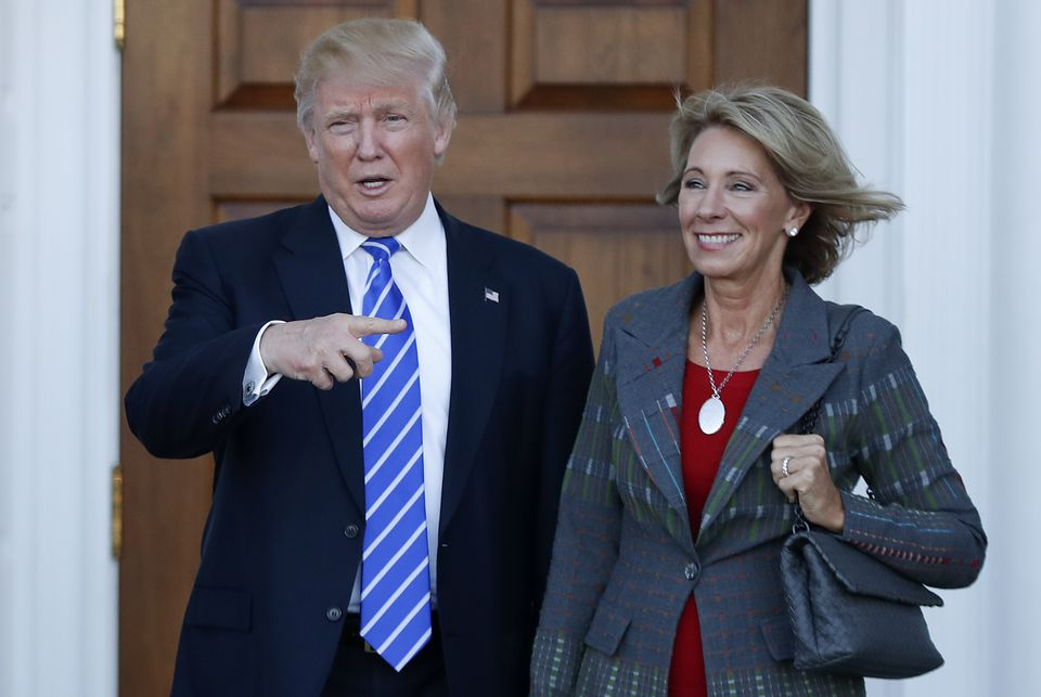 President-elect Donald Trump and Betsy DeVos posed for photographs in New Jersey Saturday.