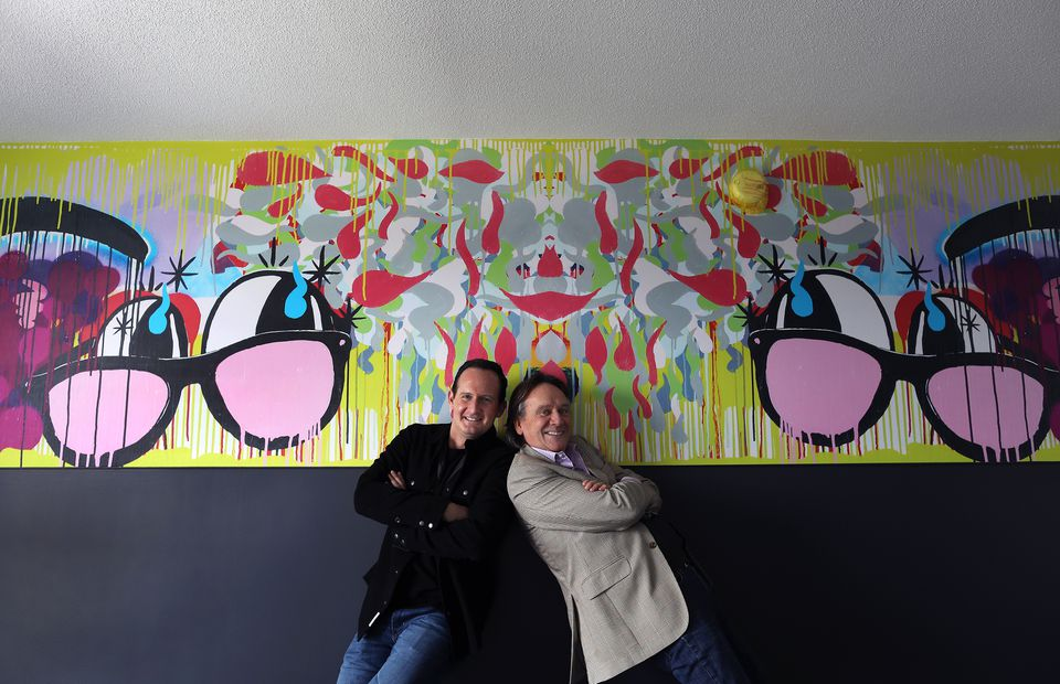 Stephen Davis, left, and Robin Alexander Brown are co-developers of a hotel called Studio Allston. They were photographed in one of the rooms with art by Thomas Buildmore.