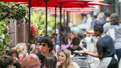 Despite light rain, customers filled up outdoor seating at restaurants along Salem Street in the North End on July 11.