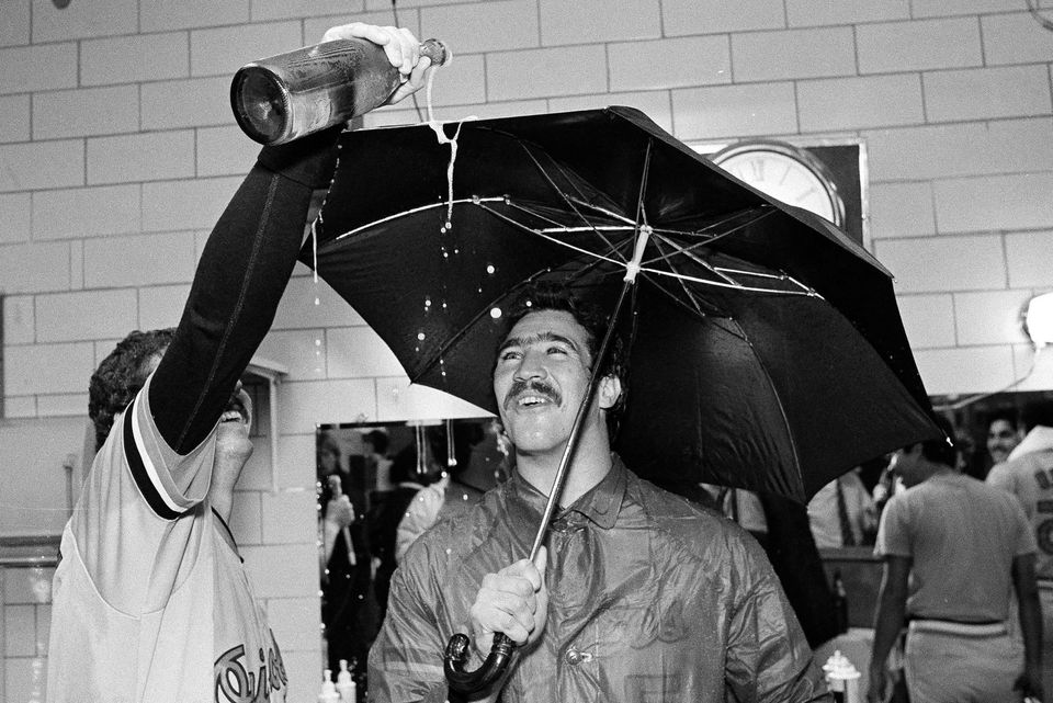 Mr. Stewart held an umbrella as teammate Bill Swaggerty poured champagne after the Orioles clinched the 1983 AL East title with a win at Milwaukee.