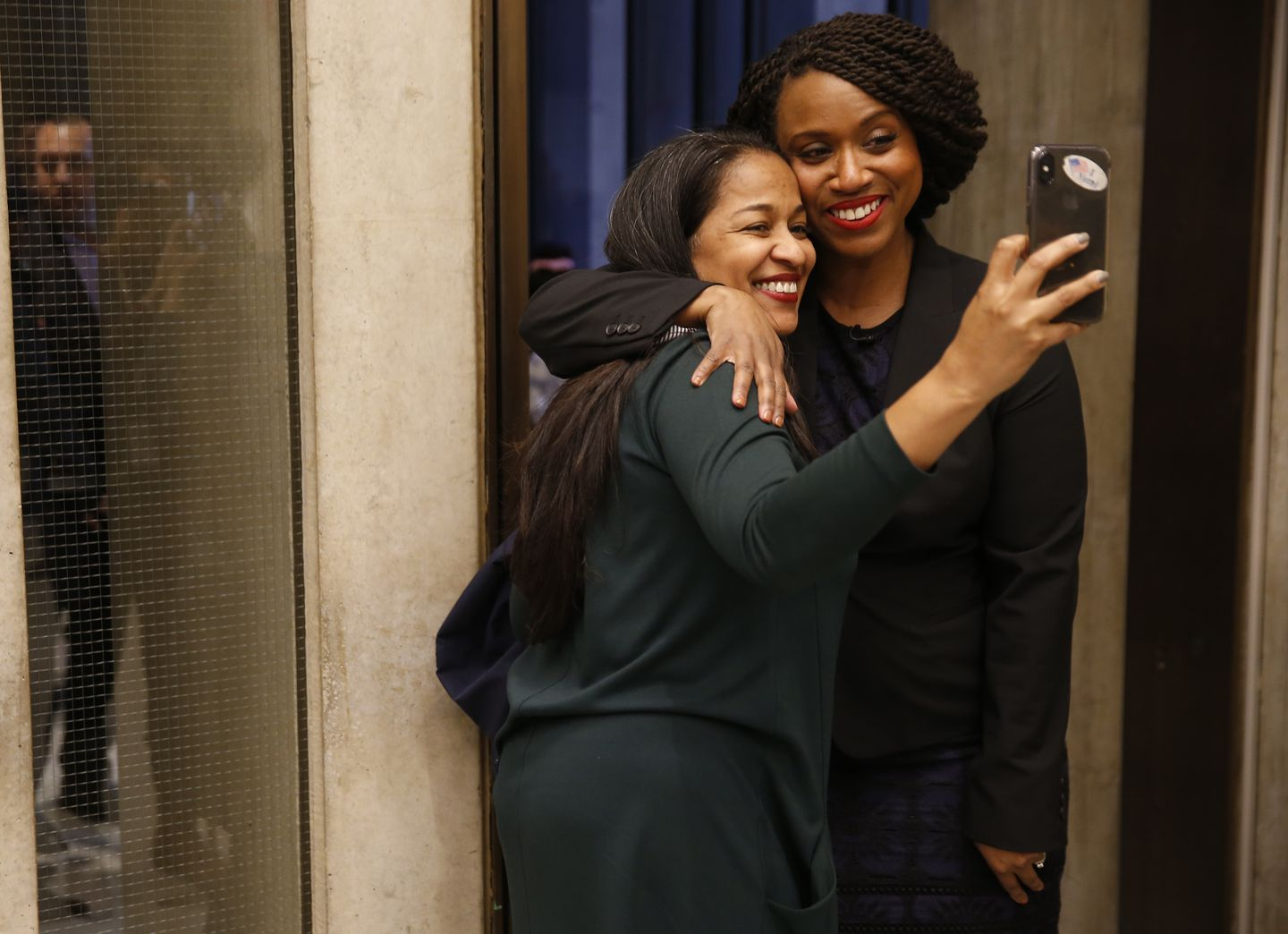 Ayanna Pressley took a photograph with a well-wisher at City Hall.