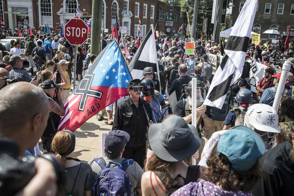 White nationalists and counter protesters rally on Aug. 12 in Charlottesville, Va.