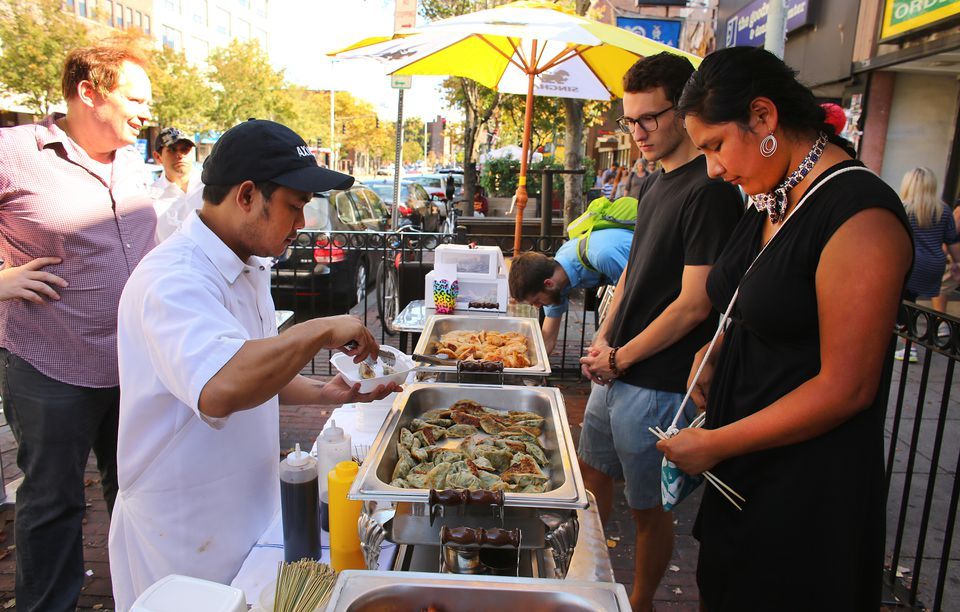 Ek Kumkaew served dumplings to Jackson Miller and Elizabeth Redlich, both of Somerville, at the Festival of Dumplings. The Central Square event honored the late Joyce Chen. She was especially known for her Peking ravioli.