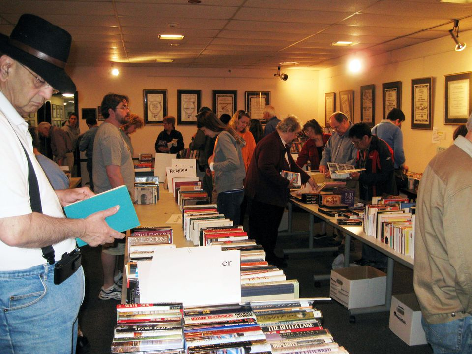 Visitors peruse offerings at a previous book and bake sale, hosted by The Friends of the Marlborough Public Library