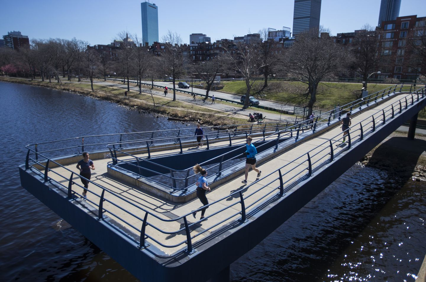 Five runners made their way on the footbridge connecting Massachusetts Avenue and the Esplanade on Monday.