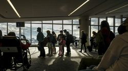 Passengers queue in an unusually sparse LaGuardia Airport in New York on Nov. 25, 2020.