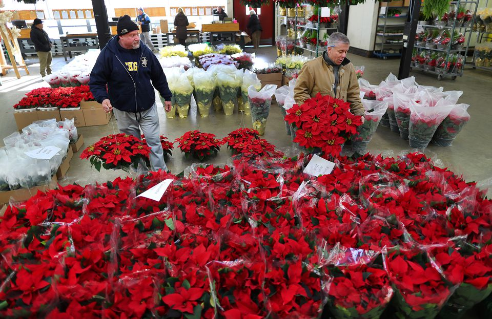 New owners have given vendors at the Boston Flower Exchange an added month to remain at its South End location.