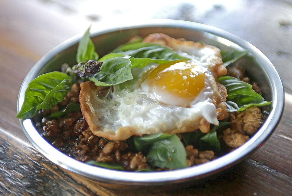 Pad gra pow, which is topped with a fried egg.