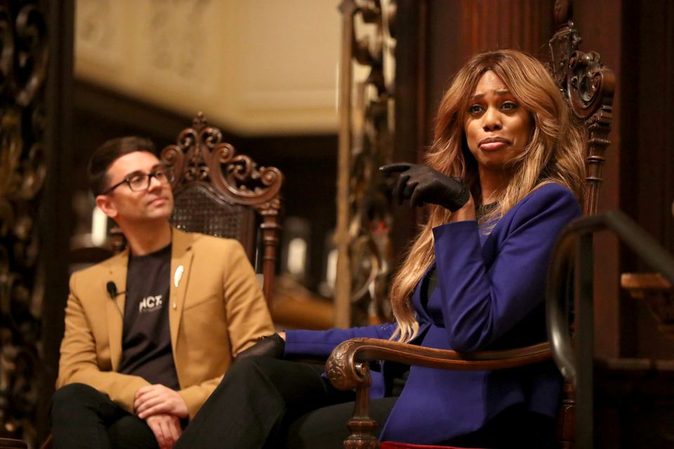 Christian Siriano, left, listens to Laverne Cox during a roundtable discussion at the 2019 Summit for Gender Equity at Harvard's Memorial Church on Tuesday, April 2, 2019.