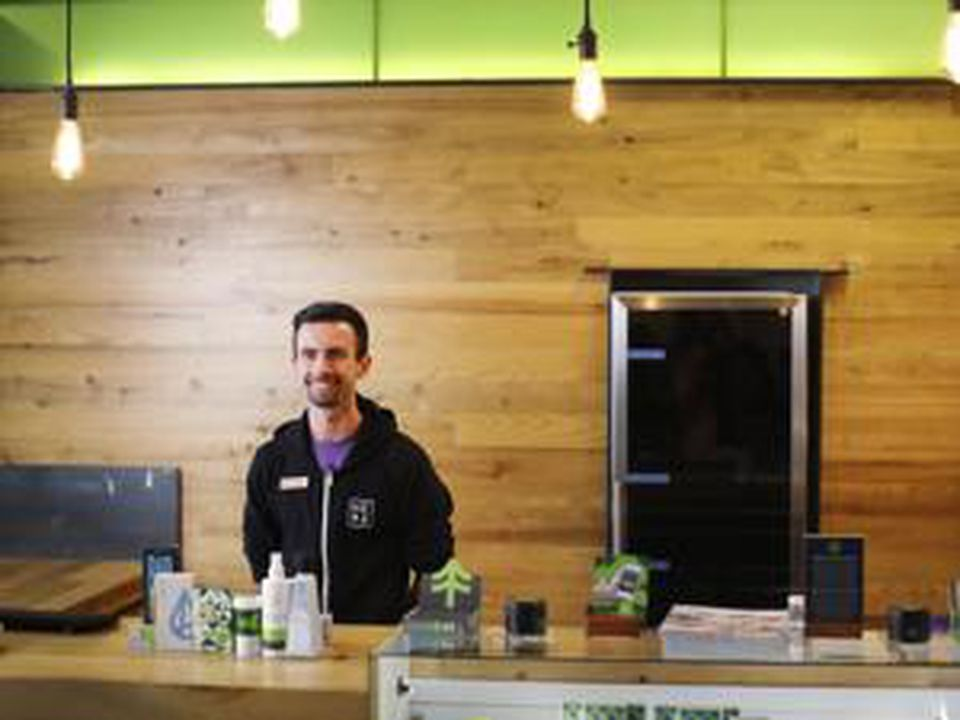 "Jake Moriarty, a Patient Service Associate a.k.a. ""Budtender"" at NETA in Northampton, Mass."