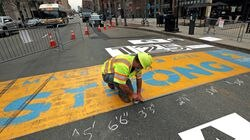 Boston Marathon finish line gets ready to be painted on Boylston Street for 2021.