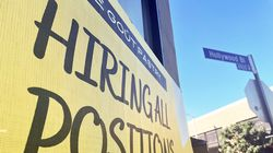 A 'Hiring All Positions' sign is displayed at a pastry shop on June 23 in Los Angeles, California.