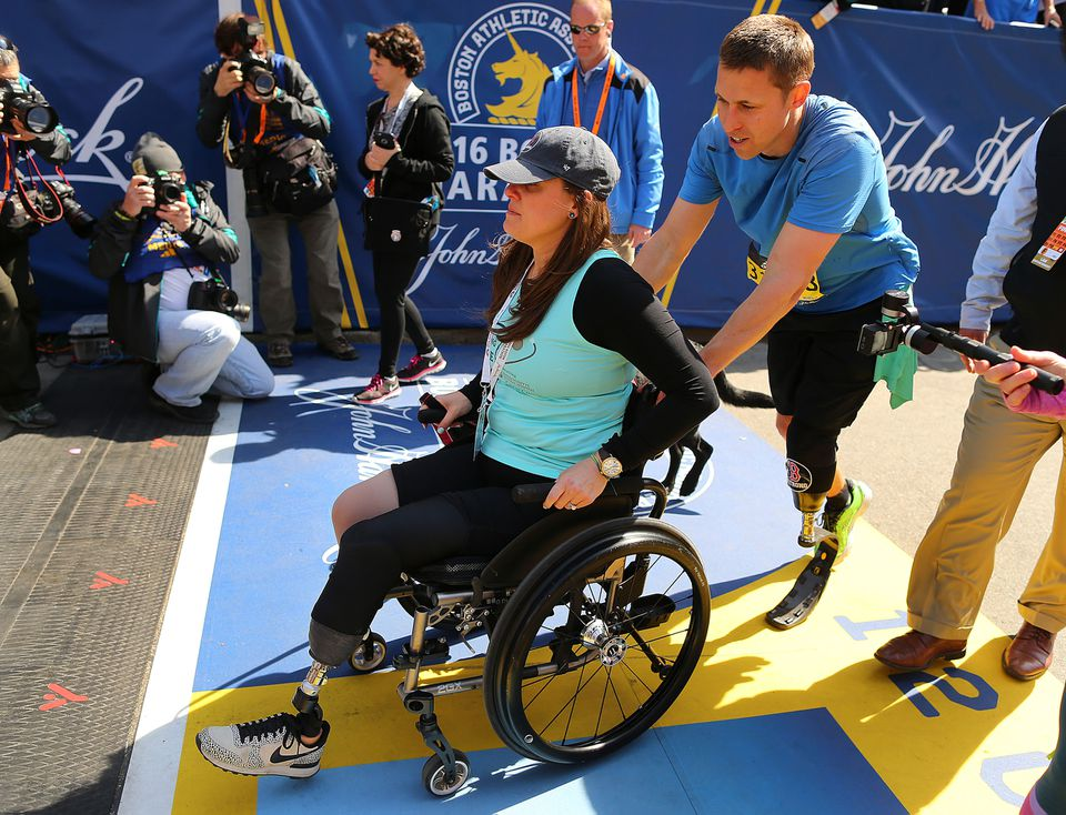 Patrick Downes was met at the finish line by Jess Kensky, his wife.