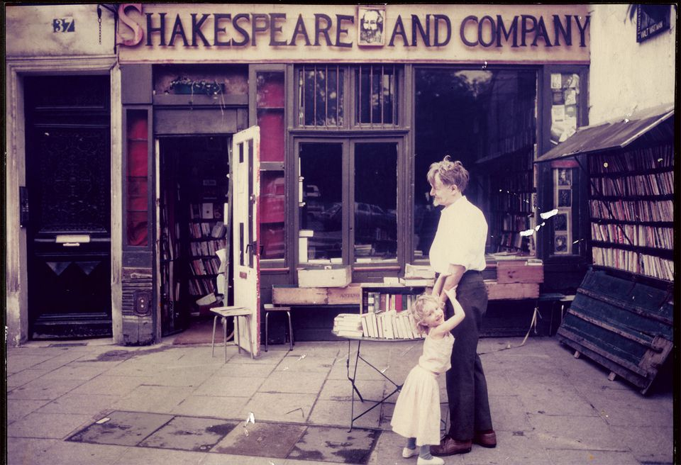 """Shakespeare and Company owner George Whitman and his daughter Sylvia in front of the Paris bookstore in 1984 from """"Shakespeare and Company, Paris: A History of the Rag & Bone Shop of the Heart."""""""