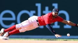 Xander Bogaerts dived but couldn't come up with this grounder up the middle in the eighth inning.