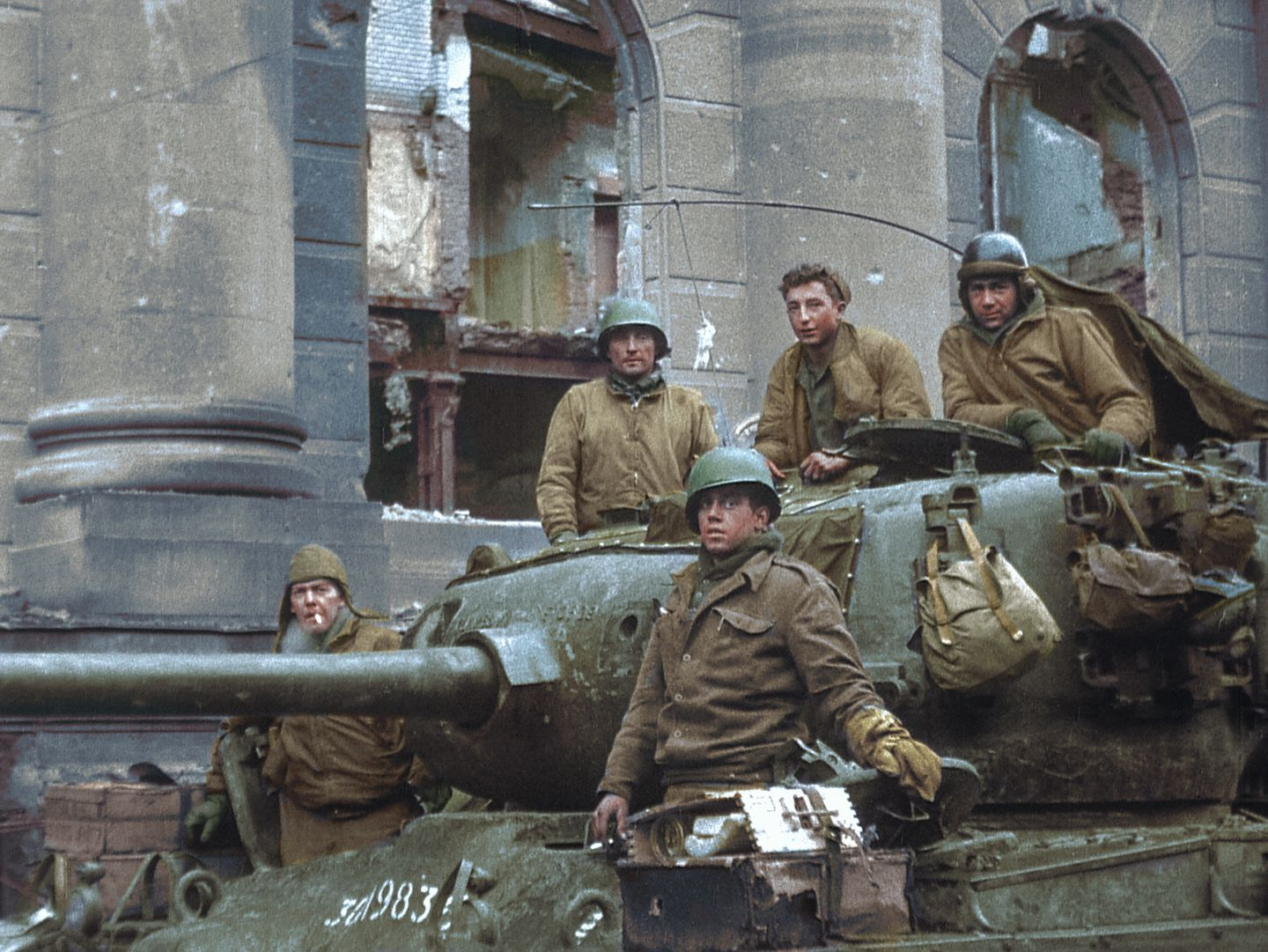 Clarence Smoyer, top center, and his crewmates were photographed with their Pershing tank on March 6, 1945, in Cologne, Germany. This image, from an Army newsreel, was taken just after they had knocked out a German Panther tank.