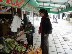 Penélope Alzamora, who has worked with Peruvian chef Gastón Acurio, buys fruit at a stall in Barranco.
